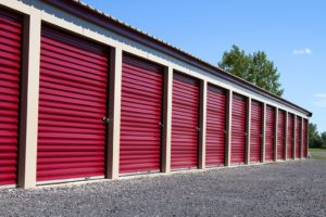 A row of mini rental units for temporary self storage in an outdoor setting.